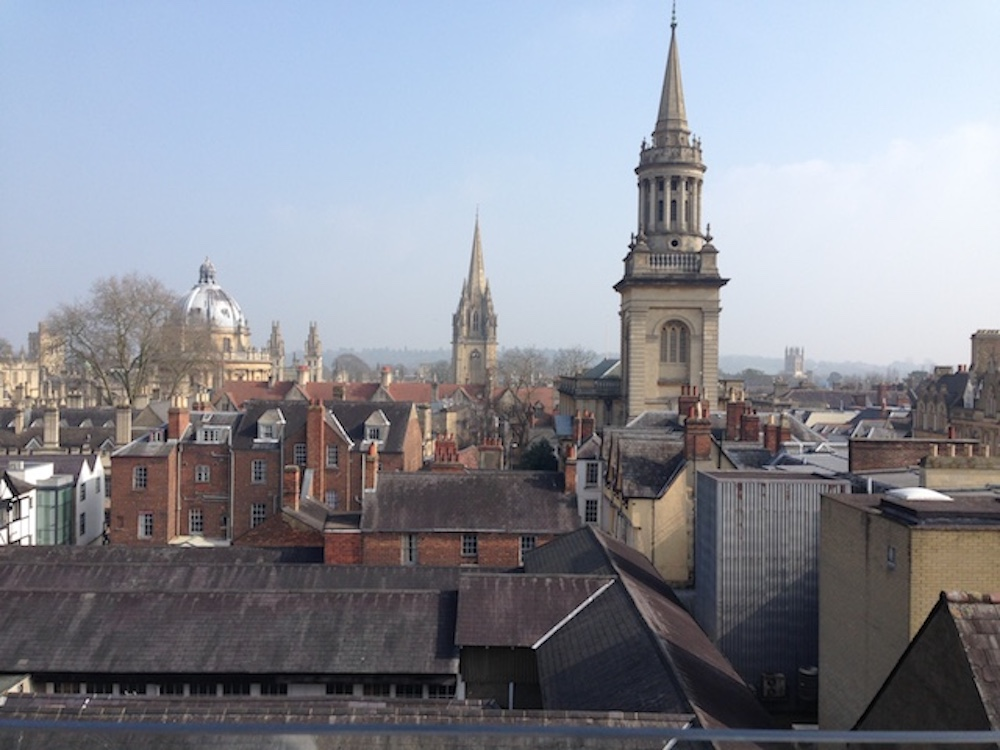 Oxford city skyline tall old buildings spires blue skies