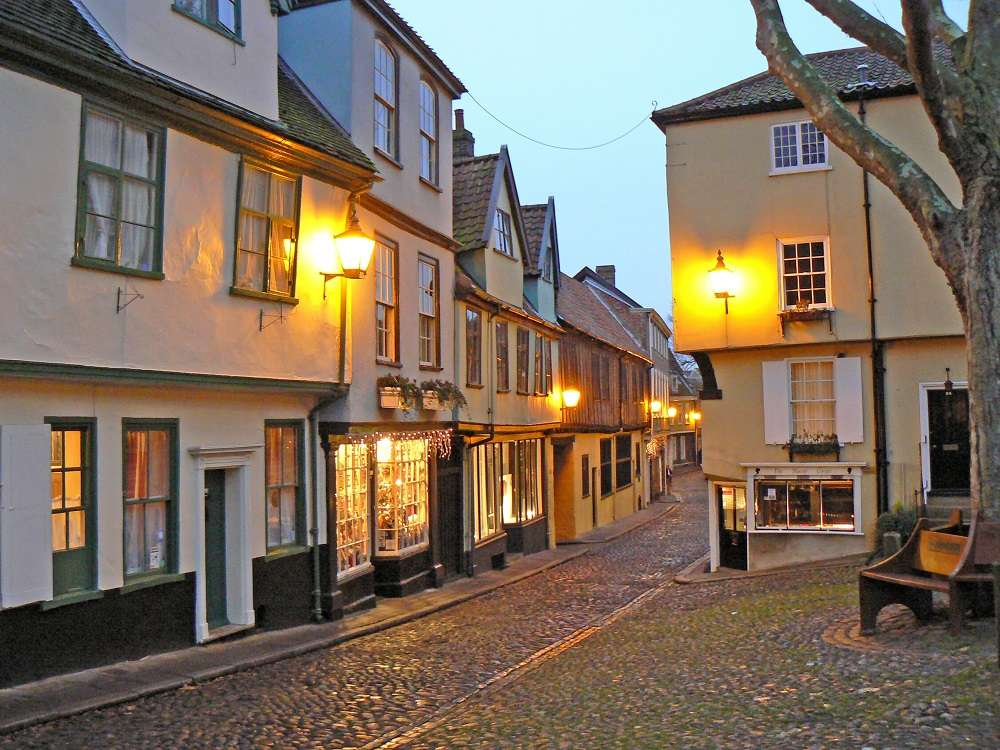 Period house and shops on cobbled street