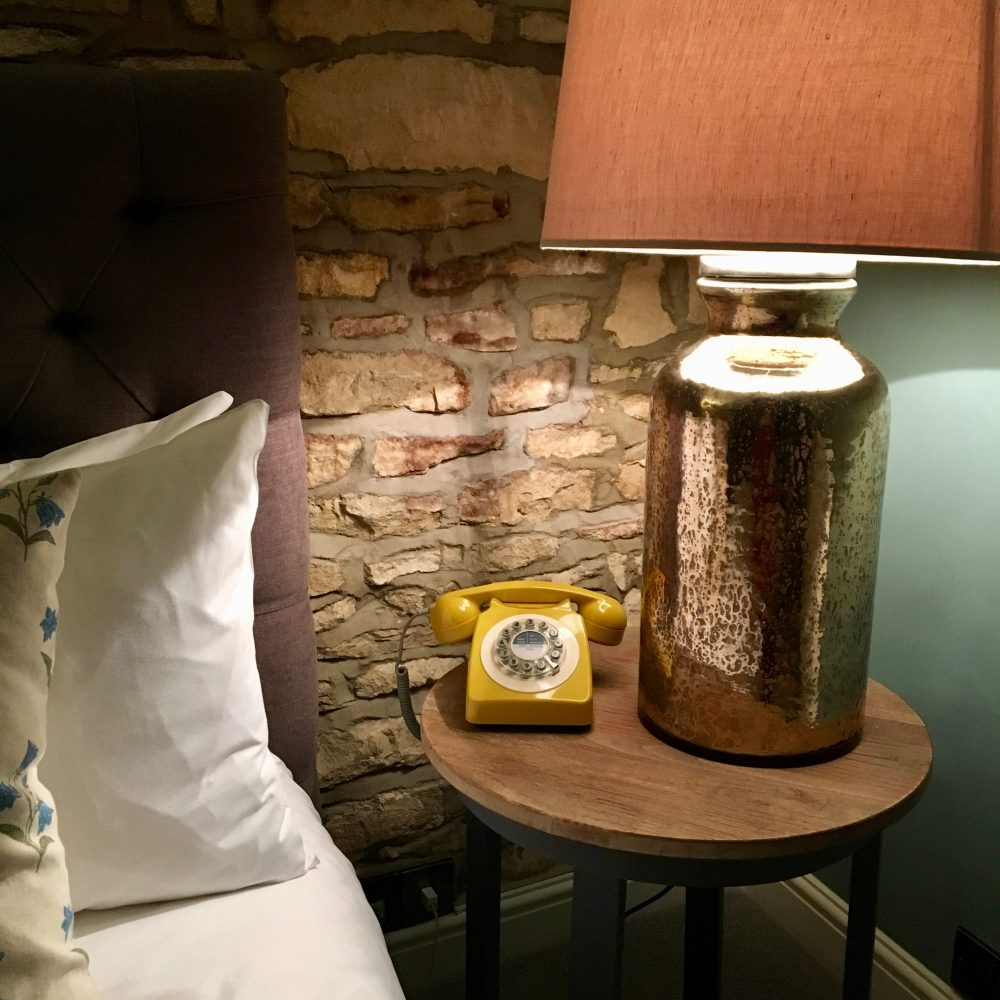yellow telephone bed bedside lamp bedside table
