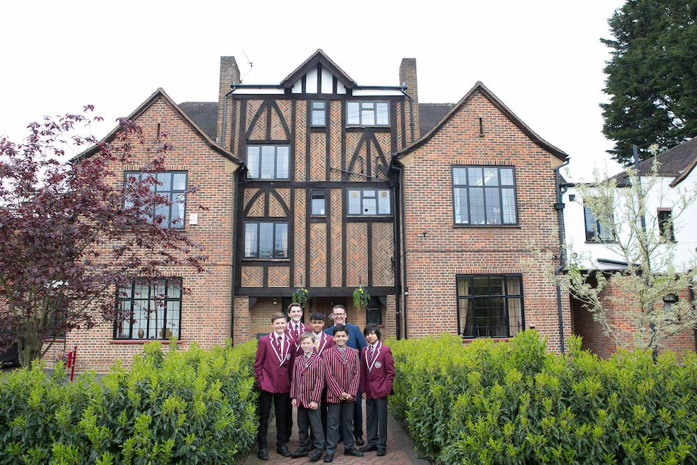 thorpe house school red brick building victorian black panels boys in uniform standing in front
