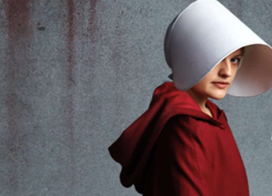 elizabeth moss in the handmaid's tale red habit white head dress