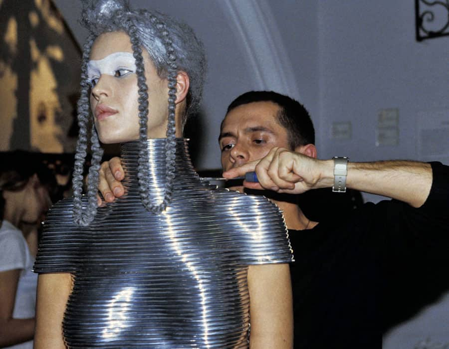 shaun leane carving metal top on model with silver hair and make up