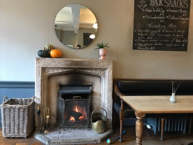 the anchor fireplace interior space chalkboard wall memy table large circle mirror