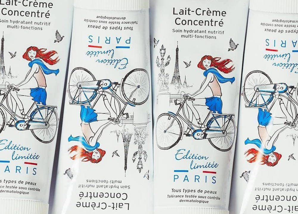 embryolisse lait creme paris illustrated magazine book woman blue red bike eiffel tower
