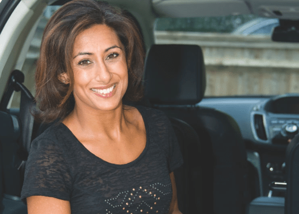 saira khan woman sat back of car smiling