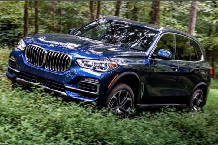New 2019 BMW X5 SUV driving ini woods
